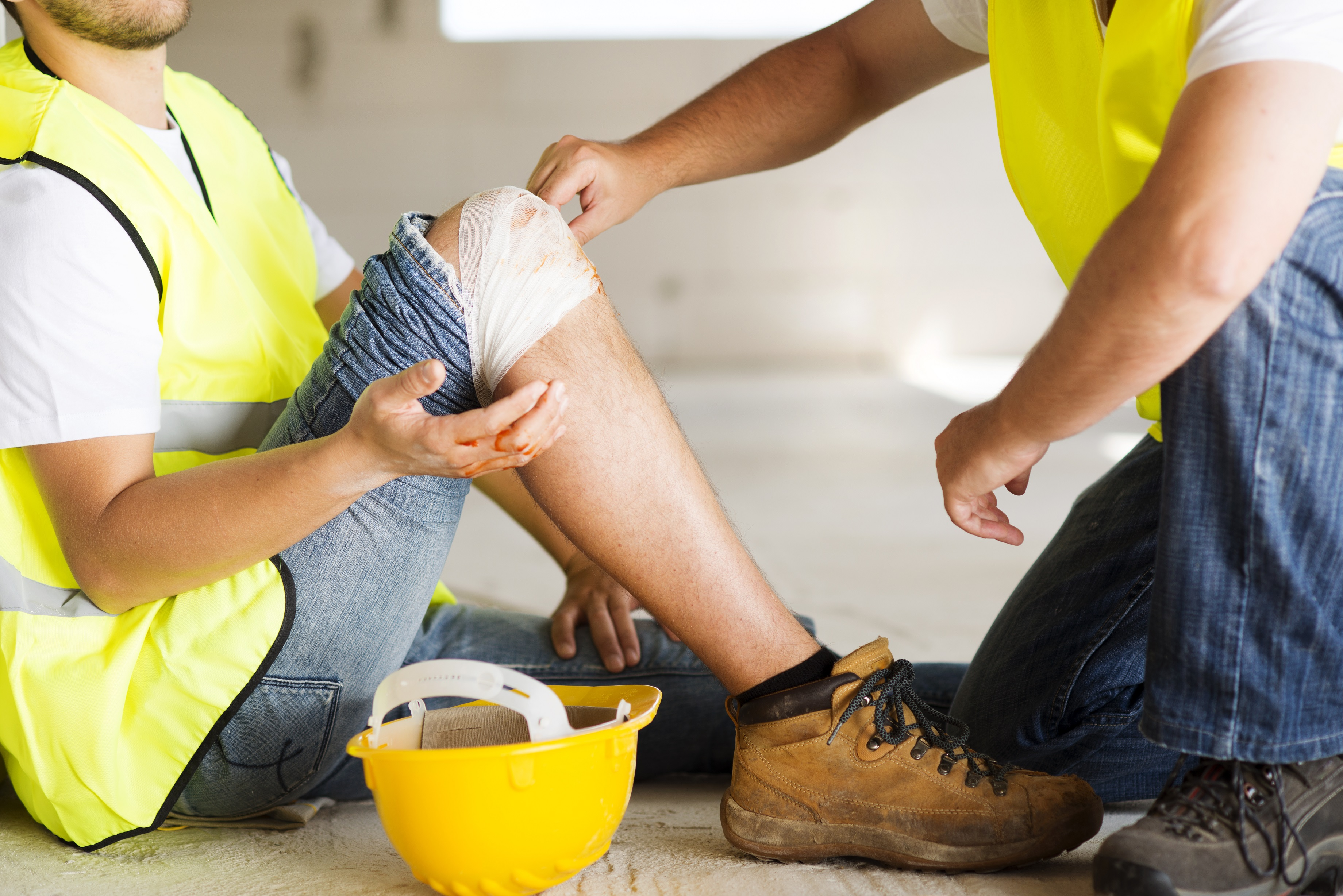worker with a knee bandage