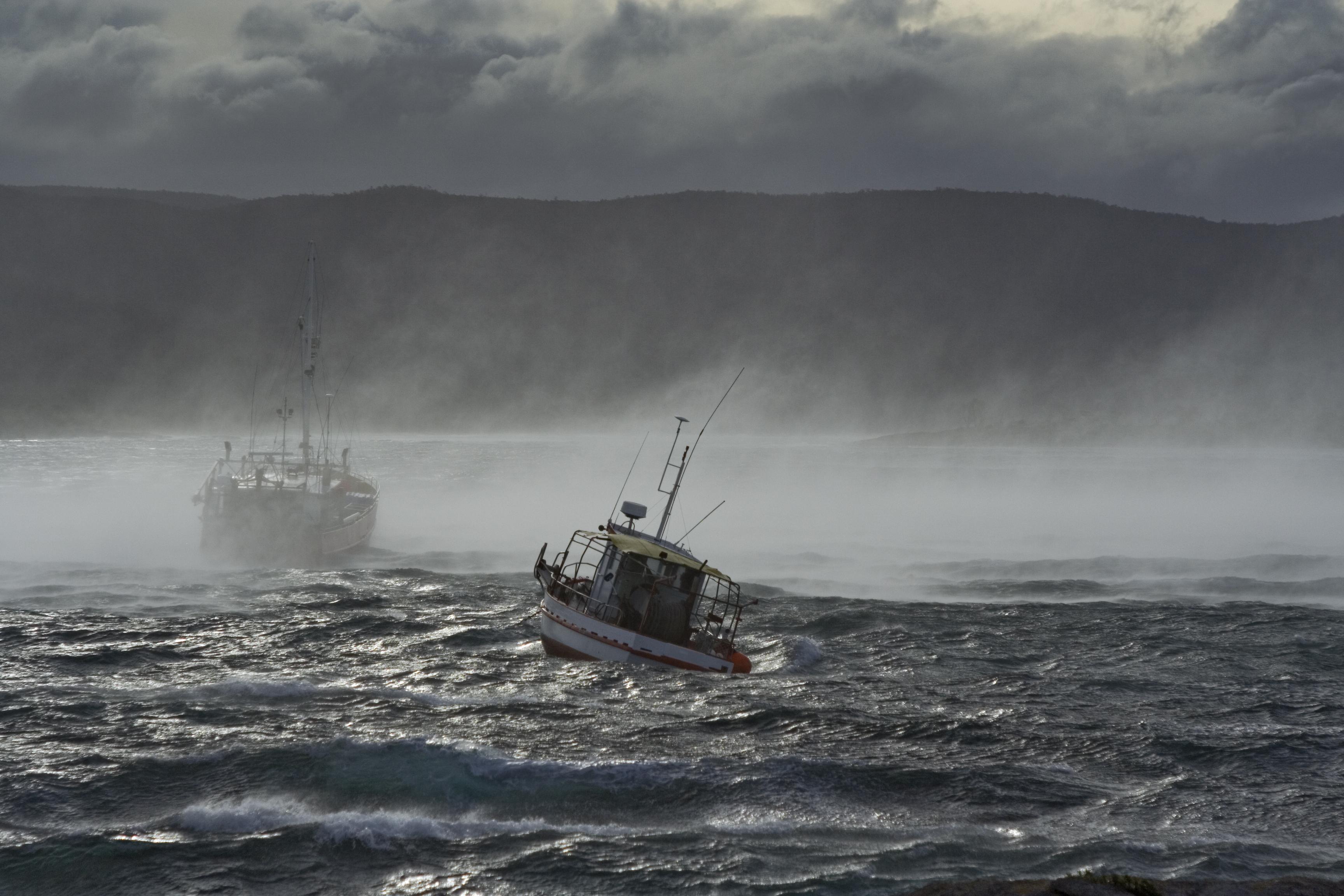 Fishing boat in misty water