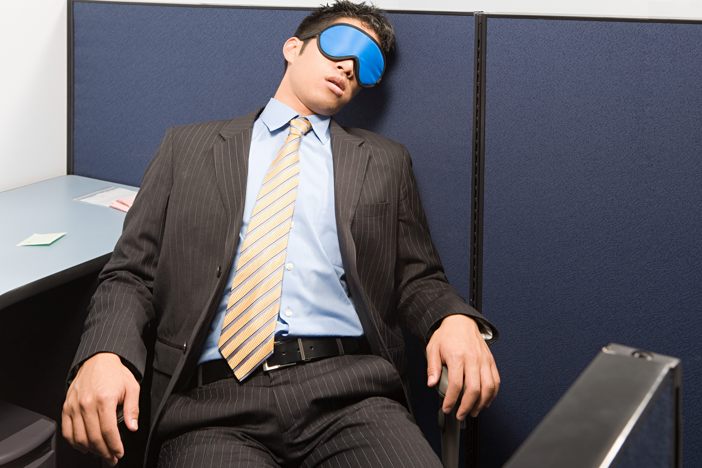 Sleeping in the office with a face mask