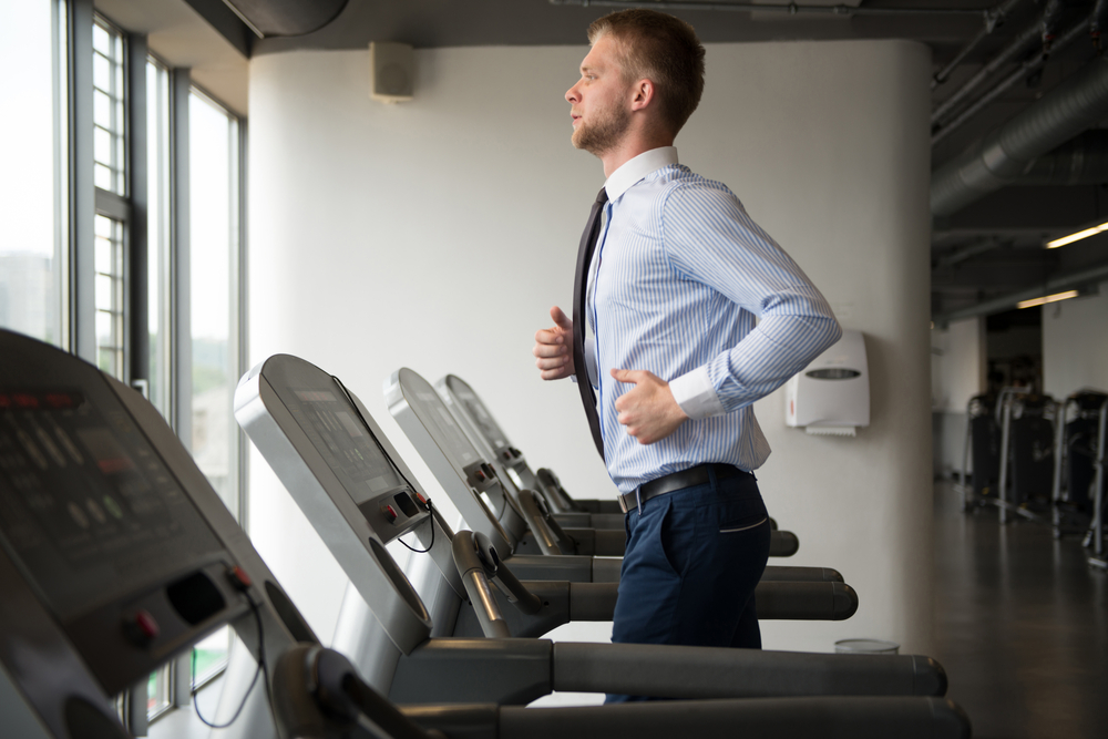 guy in suit running on treadmill