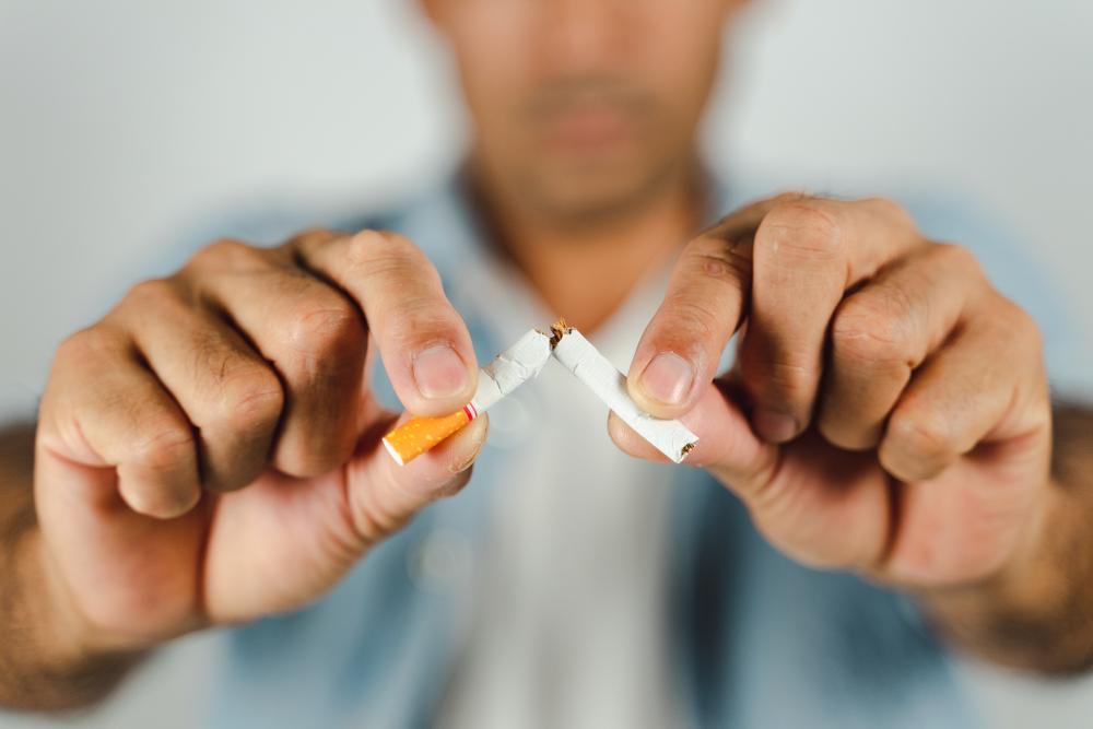 Man hand crushing cigarette
