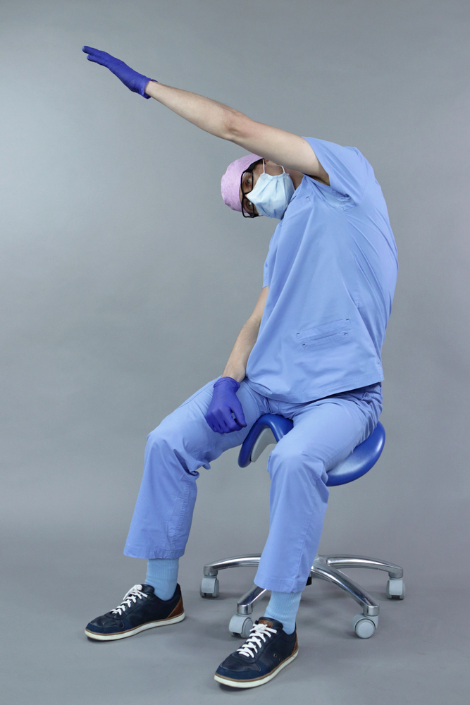 Exercise for dentist on chair in sitting position
