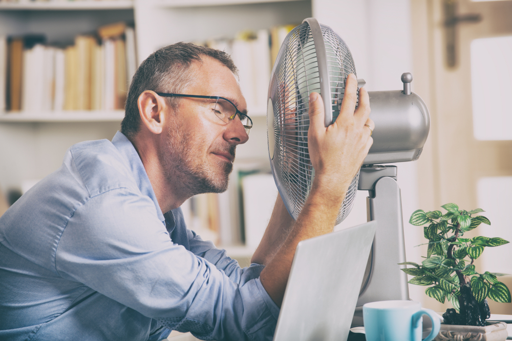 guy with face in front of fan