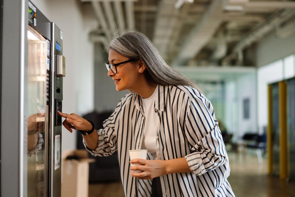 older woman using vending machine