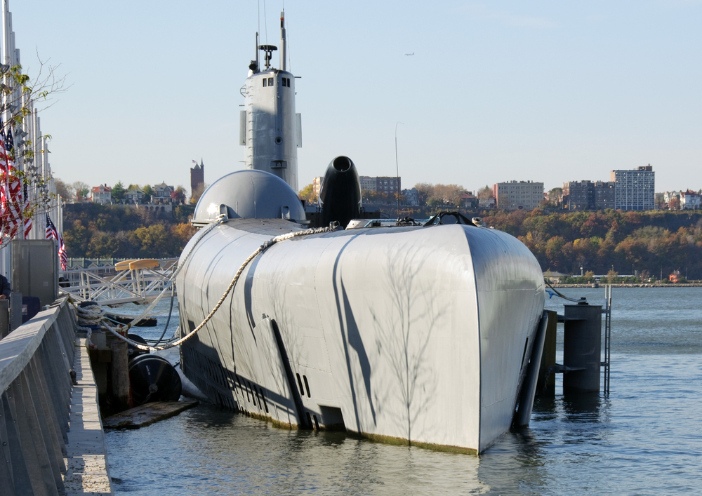 docked submarine at a pier