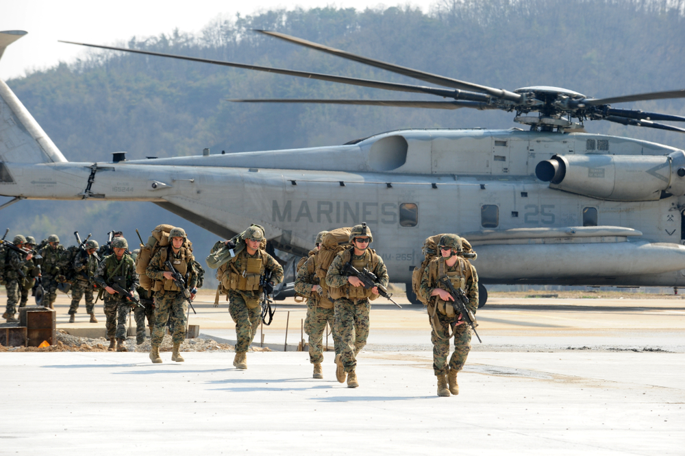 marines running from back of helicopter