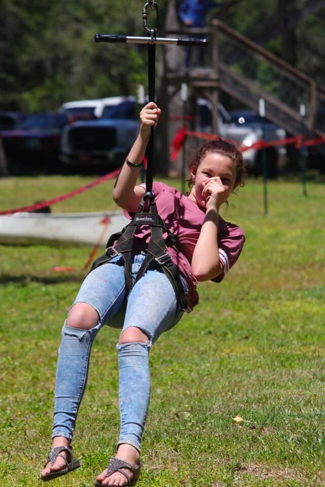 A girl riding a zipline.