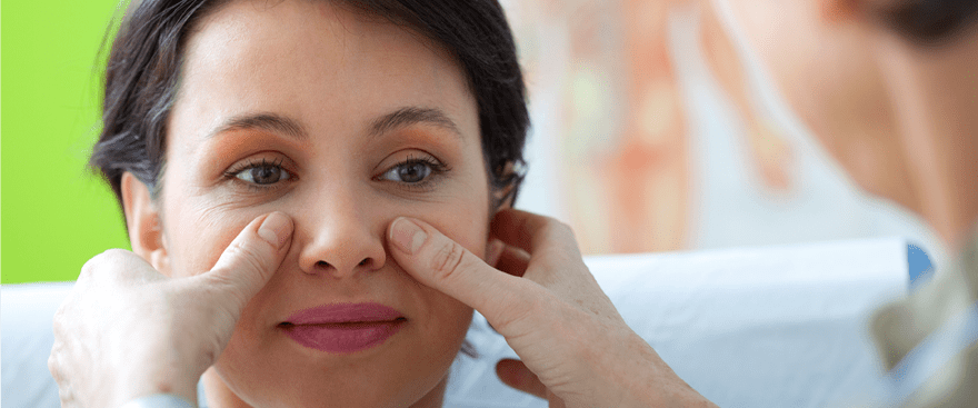 Balloon Sinus Dilation doctor inspecting woman's face