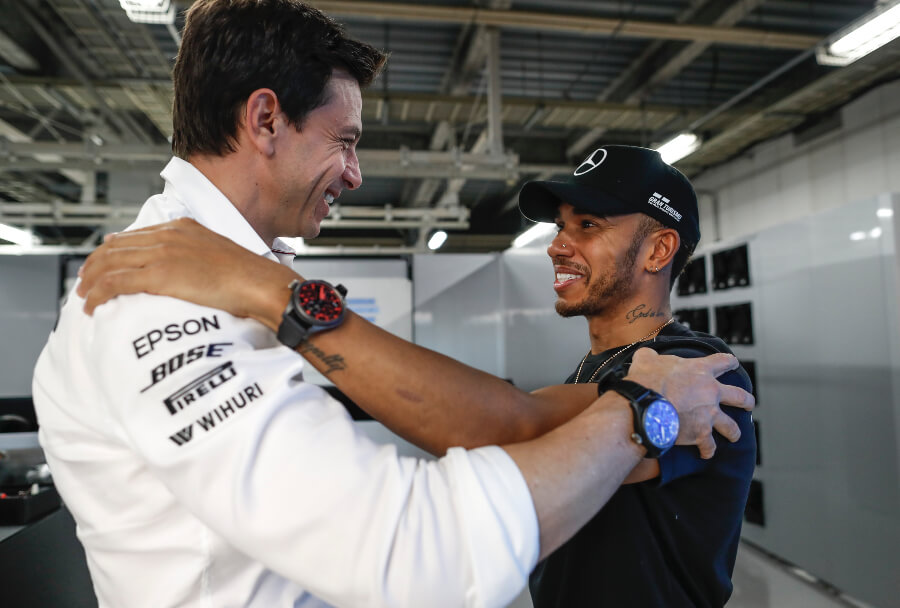 "Lewis Hamilton wearing the Pilot's Watch TOP GUN Perpetual Calendar ""Boutique Edition"" (IW502903) with Toto Wolff"