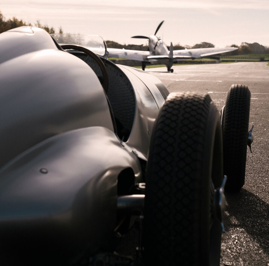 Mercedes-Benz Silver Arrow W 125 and Spitfire aircraft