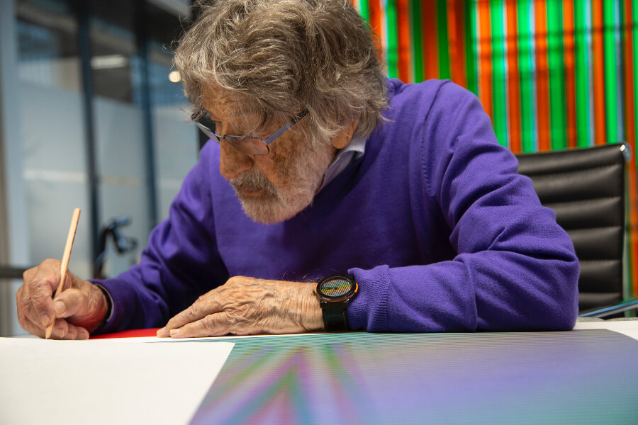 Carlos Cruz-Diez signing an artwork in his workshop, Paris, France, 2018