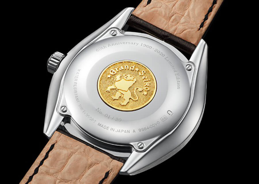 The case back carries a Grand Seiko emblem  in 18k yellow gold