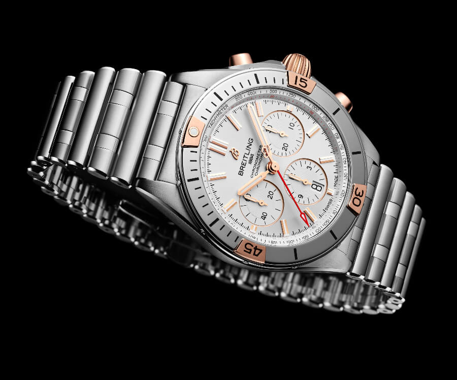 Breitling Chronomat B01 42 fitted with an 18k red gold crown and pushers and a bezel with 18 k red gold rider tabs, numerals, and indexes