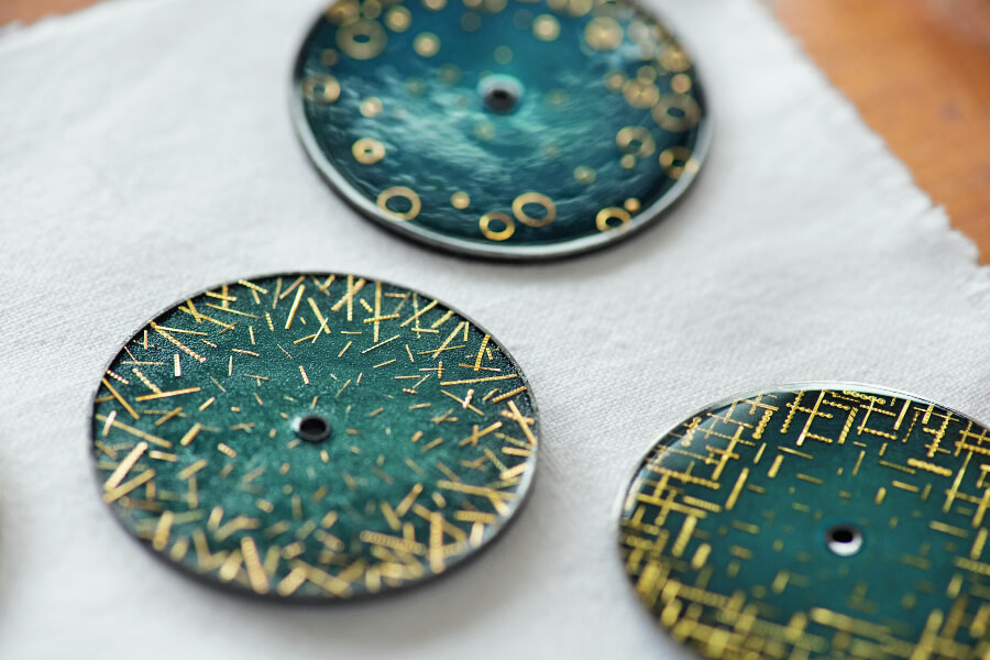 "Trilogy of ""Grand Feu"" enamel dials crafted by Anita Porchet and decorated with gold spangles over a century old"