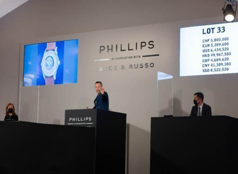"""Auctioneer Aurel Bacs selling the Patek Philippe Ref. 2523 yellow gold two-crown Worldtime """"The Silk Road"""" for CHF 7 million"""