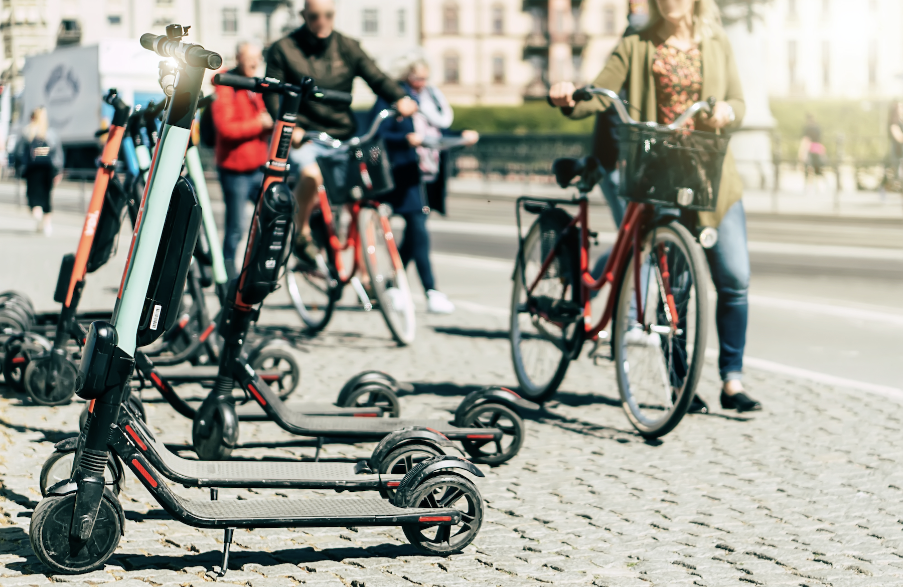 The future of micromobility, shared e-scooters and people with bicycles