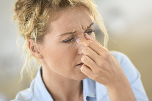 woman suffering from sinus pain