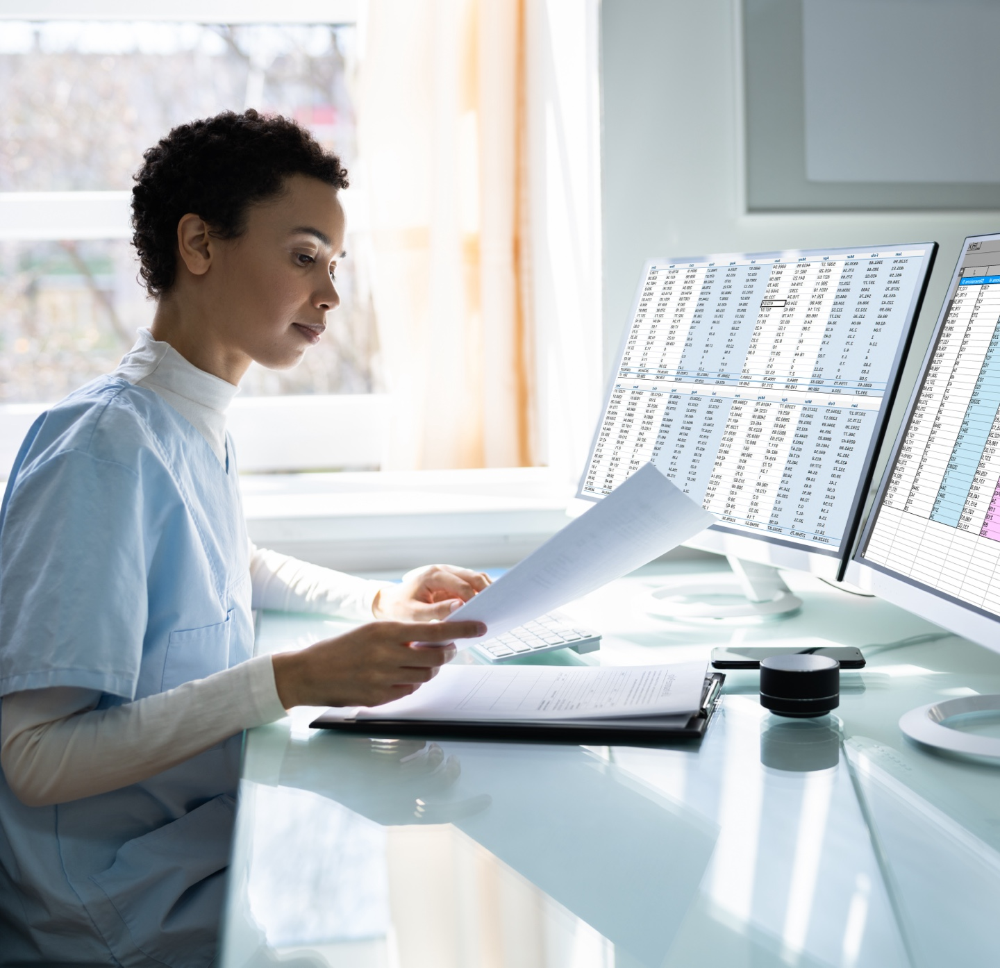 Medical employee reviewing medical billing and collections data