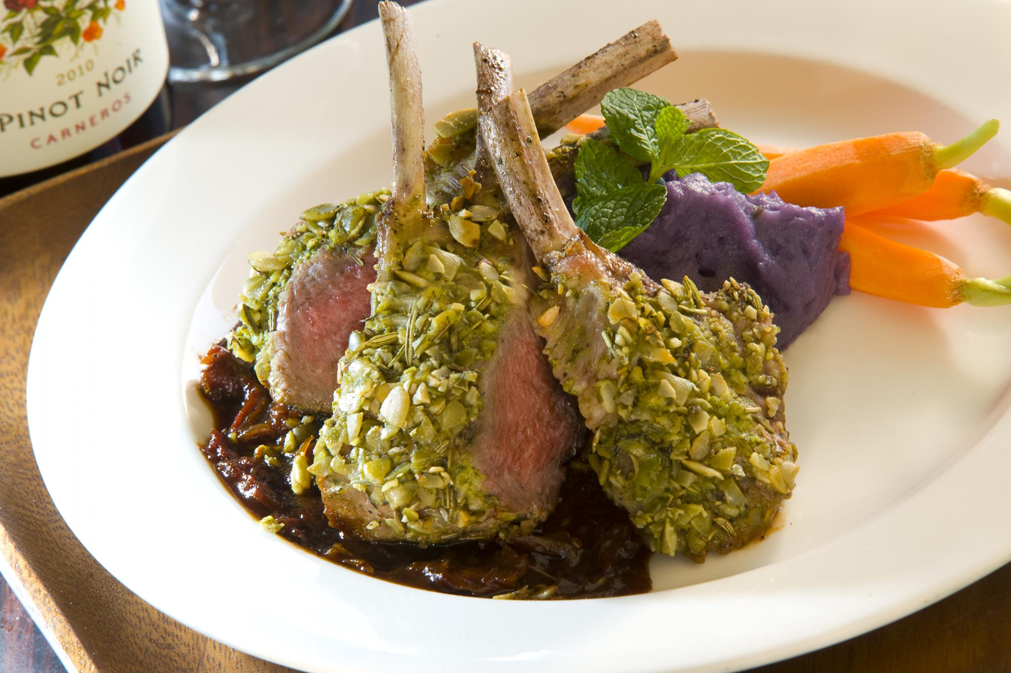 Pepita Crusted Rack of Lamb with Sun-Dried Tomato Cabernet Demi-Glace