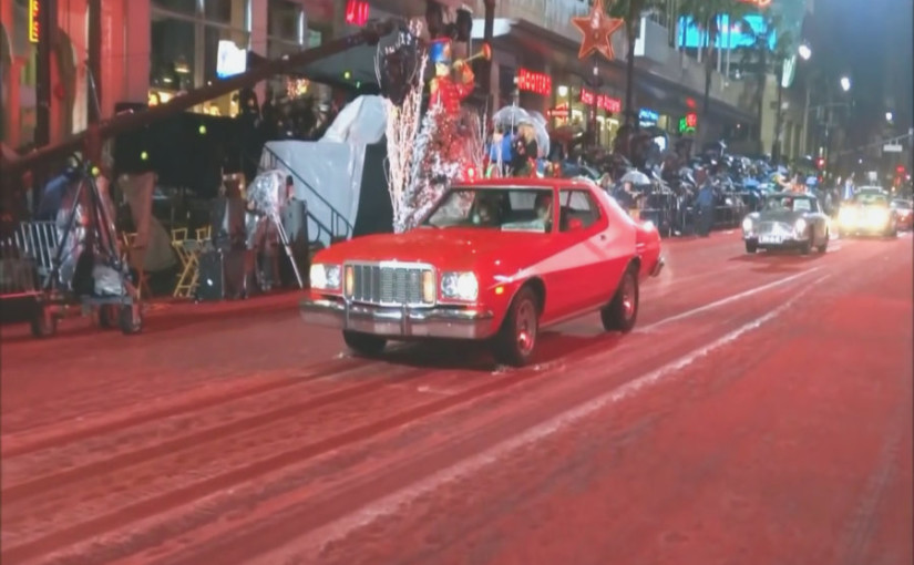 cars driving in the hollywood christmas parade