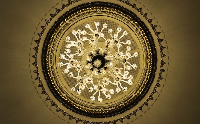 looking up at a chandelier
