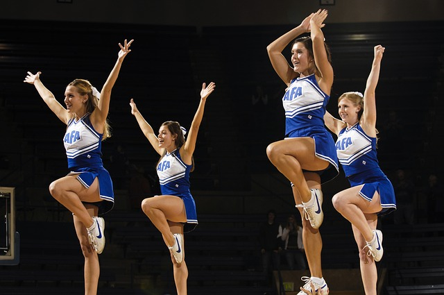 4 cheerleaders in the air