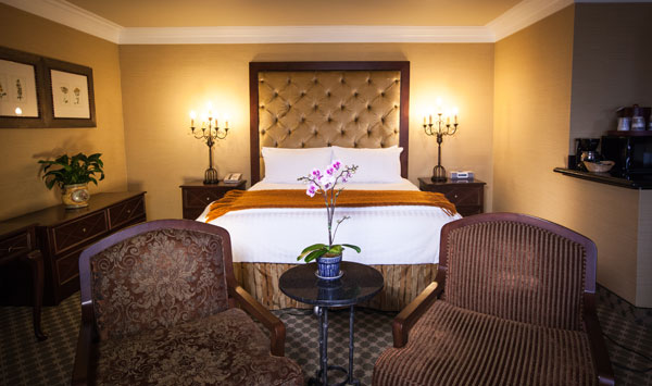 Best Western PLUS Sunset Plaza Balcony Suite Single King Room And Amenities