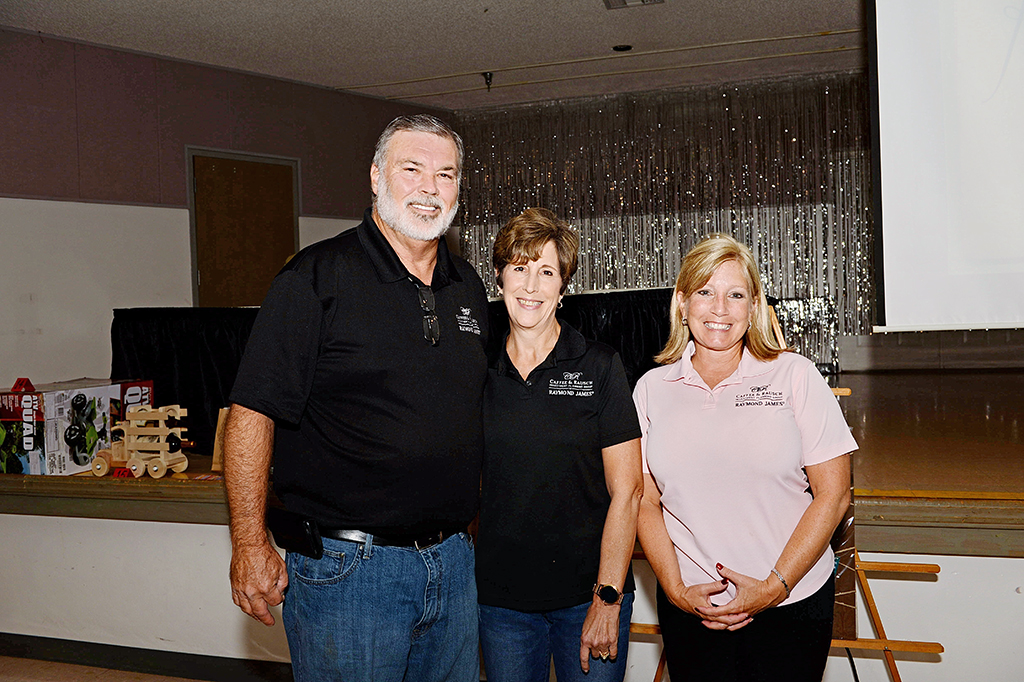 Don Rausch, Marie Rausch and Carolyn Caffee of Caffee and Rausch