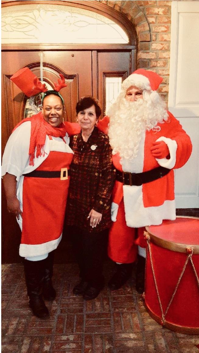 Gae Pensabene posing with board member and Santa