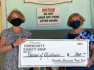 Georgi Gunnell of the Dunnellon Community Thrift Shop presents a check to Sue Carpenter of Voices for Children.