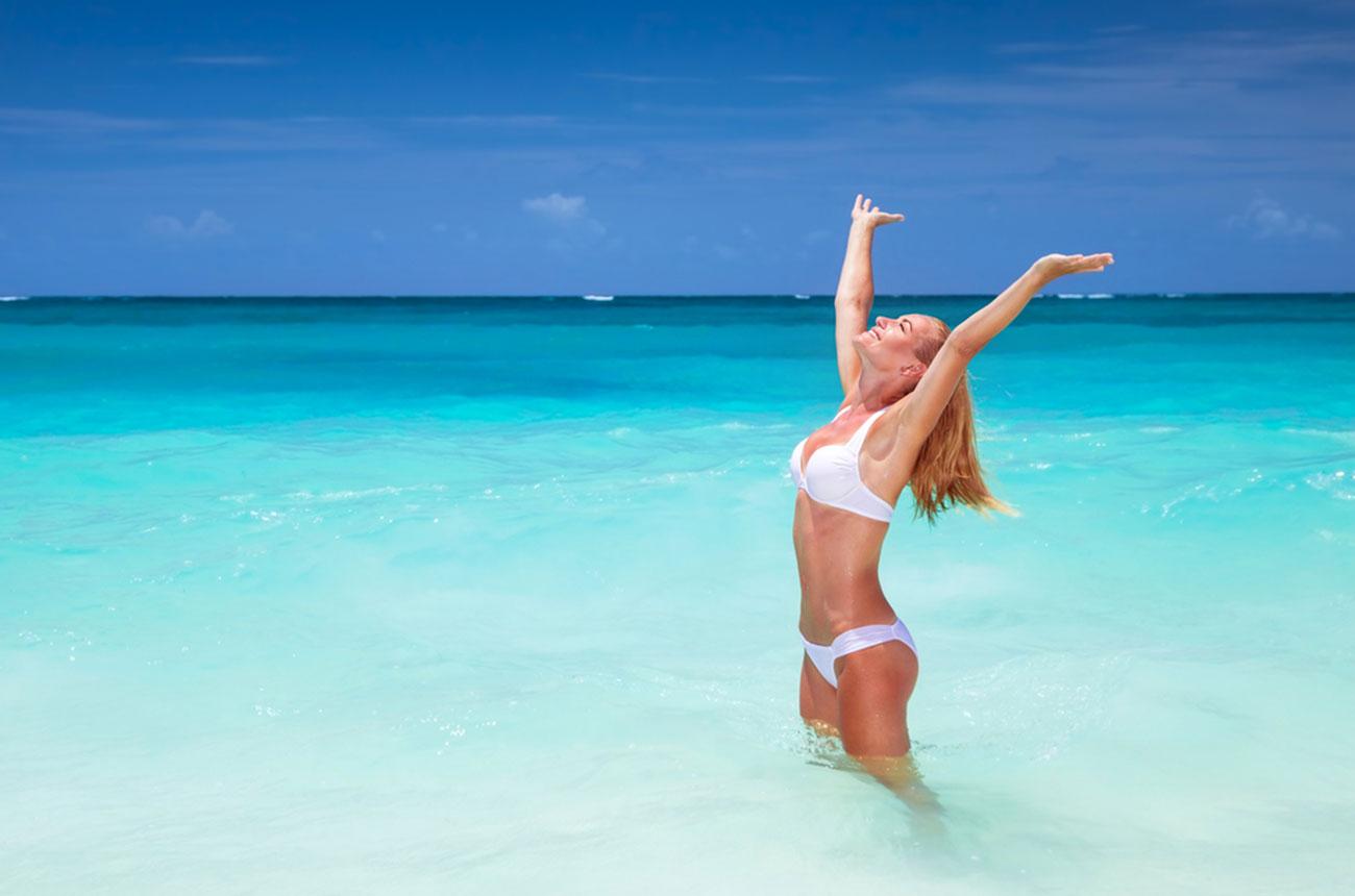 photo of girl in bikini on the beach