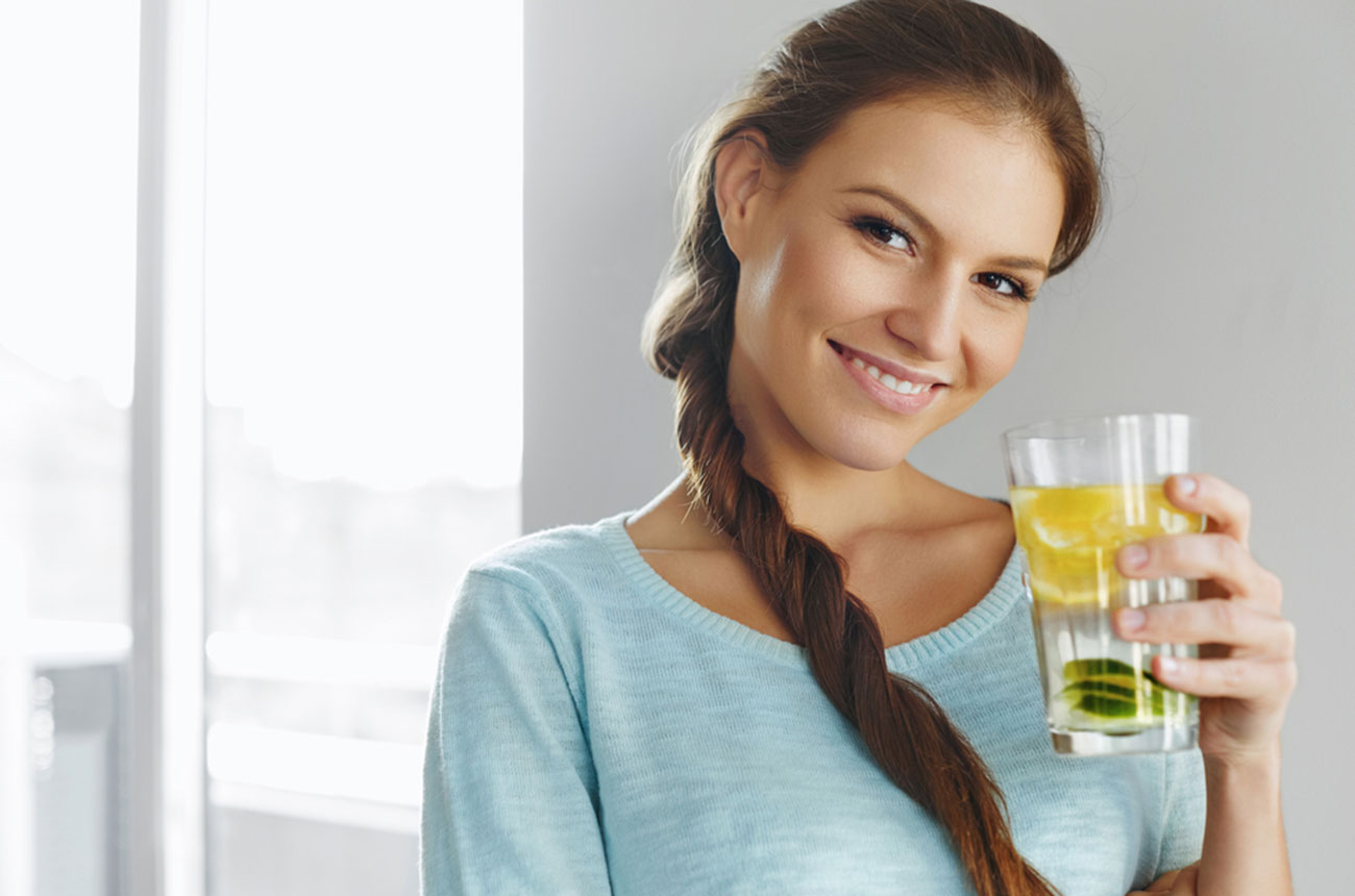 photo of healthy girl drinking water