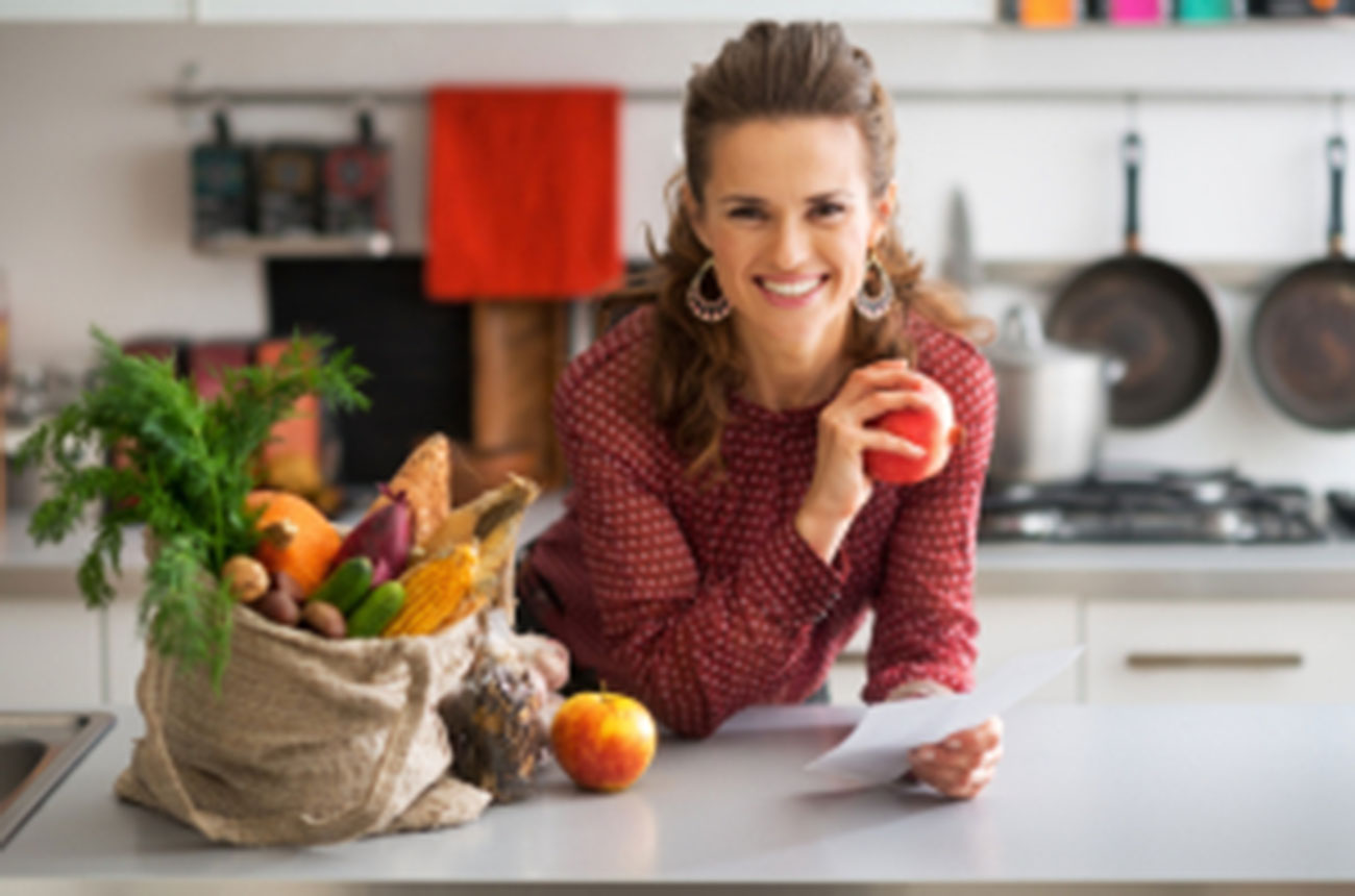 photo of woman in kitchen with fruit