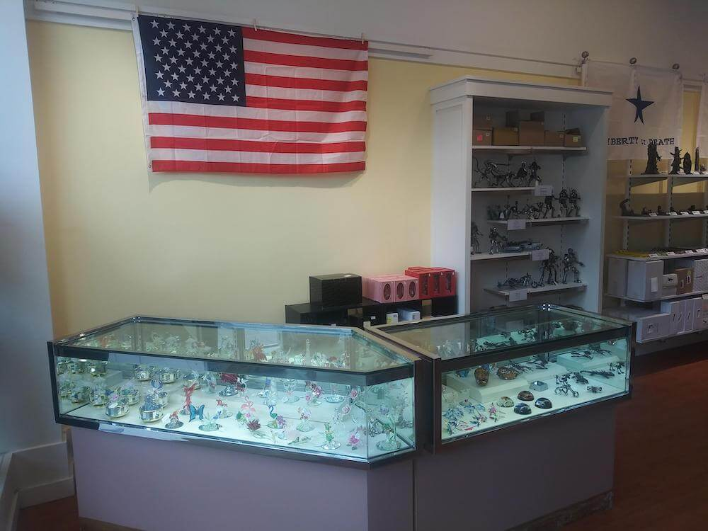 Photo of showcase with glass figurines