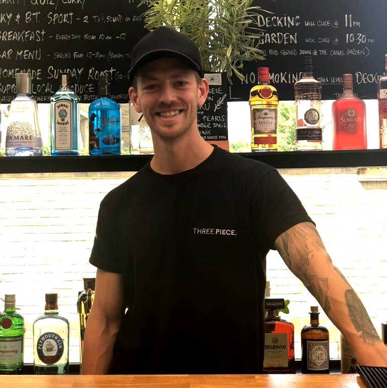 image of customer saying cheers to the barman with a beautiful drink in hand