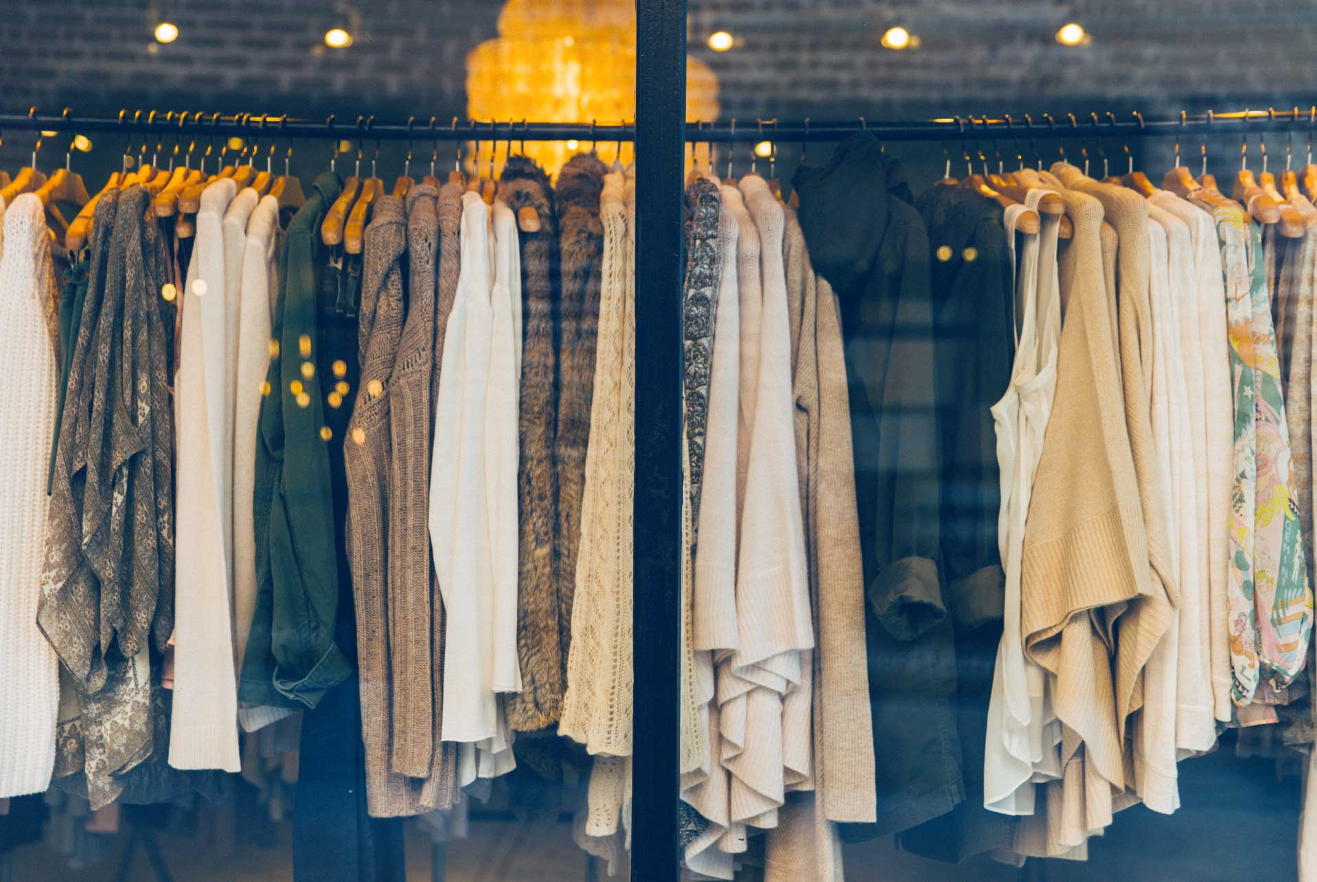 2 stylish friends looking at a consumer shopping app | PredictSpring