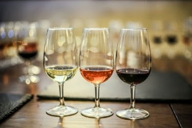 Wine tasting - three different glasses of wine