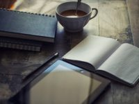 cup of coffee and book of notes