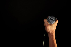 person holding a microphone