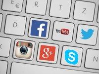 social media logos on computer keys