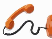 orange corded telephone
