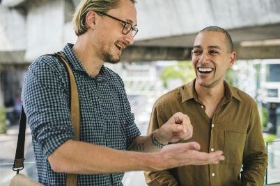 men laughing over a joke