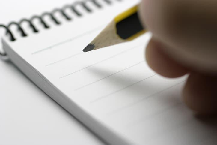 writing down marketing notes