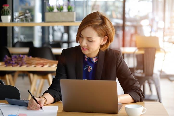 woman taking marketing notes
