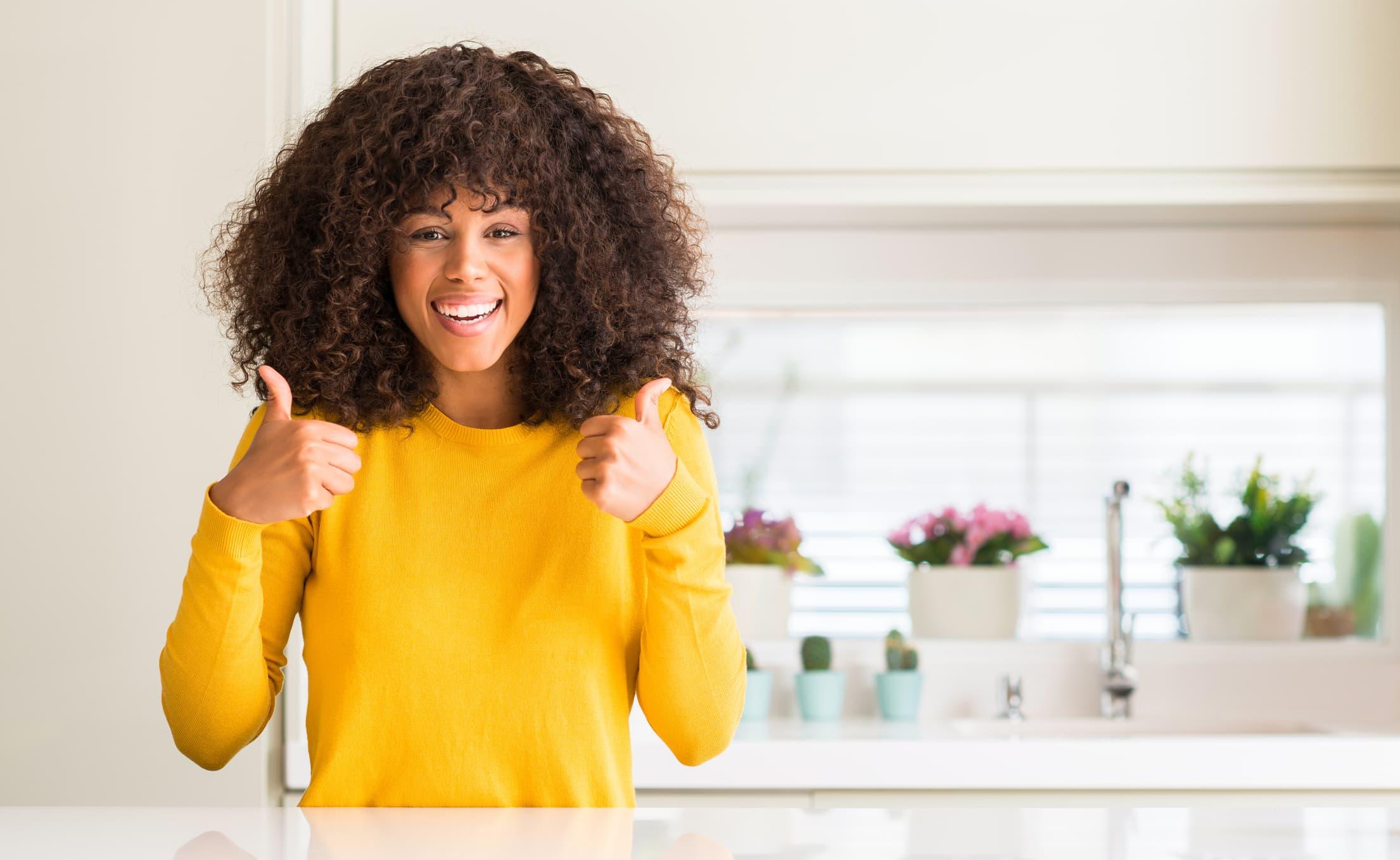 woman smiling about savings