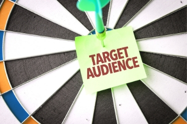 target audience post-it note on dart board
