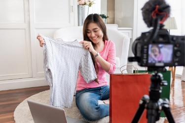 woman being recorded while reviewing a product