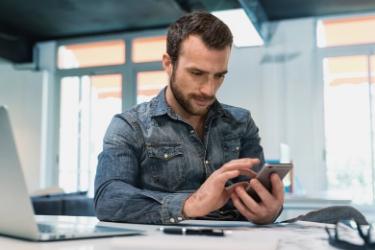 man checking his phone