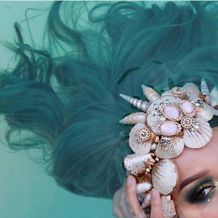 woman with seashell crown
