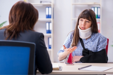 Injured Employee talking to her Employer